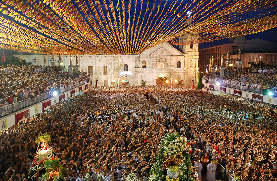 Thousands gather for mass at the Basilica del Santo Nino in Cebu during Sinulog week to celebrate their patron saint.